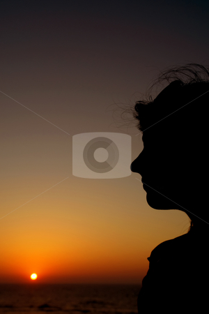 Silhouette stock photo, Woman silhouette at sunset by Rui Vale de Sousa