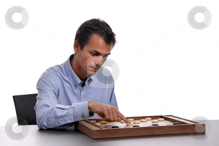 Playing stock photo, Young man playing a game isolated on white by Rui Vale de Sousa