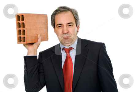 Brick stock photo, Mature business man with a brick, on white by Rui Vale de Sousa