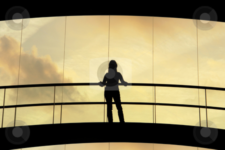 Woman stock photo, Woman in the modern building at sunset by Rui Vale de Sousa