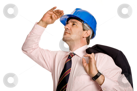 Looking stock photo, An engineer with blue hat, isolated on white by Rui Vale de Sousa