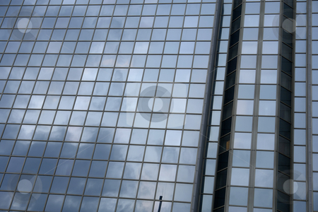 Building stock photo, Modern office building and the clouds reflection by Rui Vale de Sousa