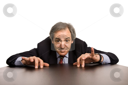 Silly stock photo, Mature business man on a desk, isolated on white by Rui Vale de Sousa