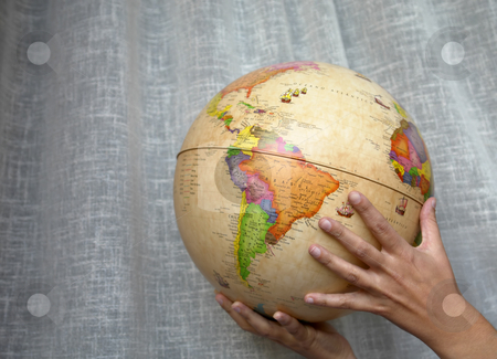 Globe stock photo, Woman hands holding a world globe detail by Rui Vale de Sousa