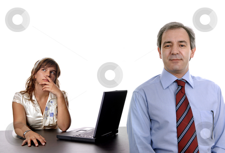Working stock photo, Young business couple working in the office by Rui Vale de Sousa