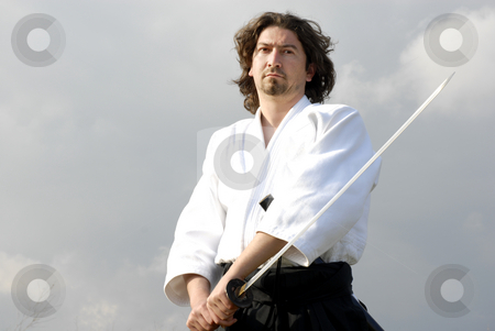 Samurai stock photo, Young aikido man with a sword, outdoors by Rui Vale de Sousa