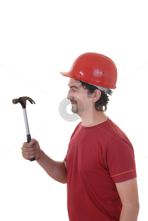 Hammer stock photo, Young man working with a hammer and a hat by Rui Vale de Sousa