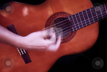 Play stock photo, Human man hand playing fast guitar detail by Rui Vale de Sousa