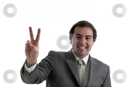 Victory stock photo, Young businessman showing two fingers isolated on white by Rui Vale de Sousa