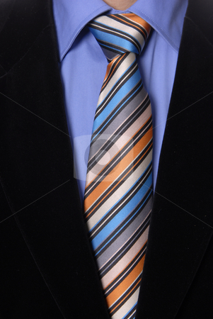 Tie stock photo, Detail of a Business man Suit with colored tie by Rui Vale de Sousa