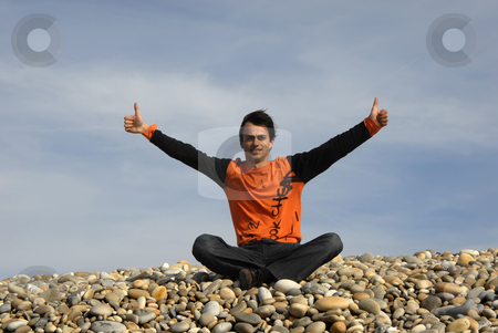 Thumbs up  stock photo, Man with arms wide open at the beach by Rui Vale de Sousa
