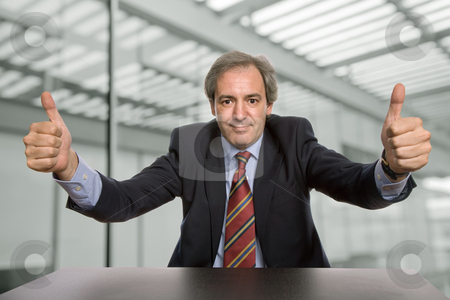 Thumbs up stock photo, Business man going thumbs up at the office by Rui Vale de Sousa