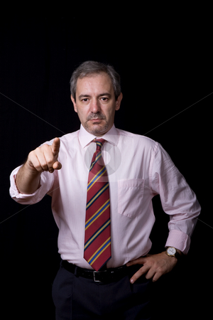 Pointing stock photo, Mature business man portrait on black background by Rui Vale de Sousa