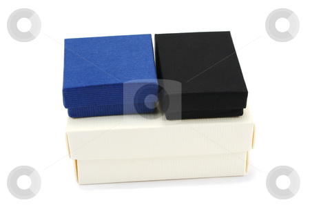 Three Gift Boxes stock photo, Two small gift boxes on a larger cream gift box by Helen Shorey
