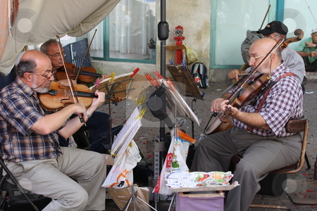 Playing violins at a street fair in Tel Aviv stock photo,  by Chris Budd