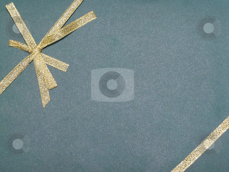 Top of gift stock photo, Top of gift with golden tie in a bow by Sergej Razvodovskij