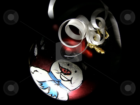 Snowman stock photo, Christmas snowman on the red fir toy  at the night by Sergej Razvodovskij