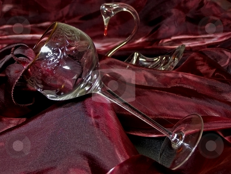 Tissue, cut-glass and swan stock photo, Wineglass from crystal against red tissue and swan figure by Sergej Razvodovskij
