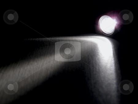 Night flashlight stock photo, Lighting flashlight at dark night with light like arow by Sergej Razvodovskij