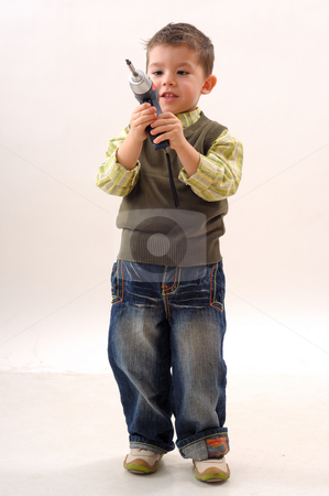 Tools and child stock photo, Tools for construction and a little boy using them by Dragos Iliescu