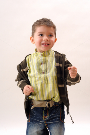 Smiling boy stock photo, Happy boy dancing and playing by Dragos Iliescu