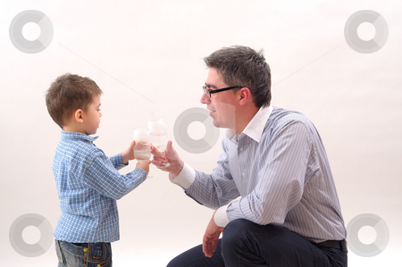 Father and son stock photo, Father and son celebrating the success by Dragos Iliescu