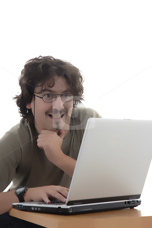 Work stock photo, Young man laughing wile working with computer by Rui Vale de Sousa