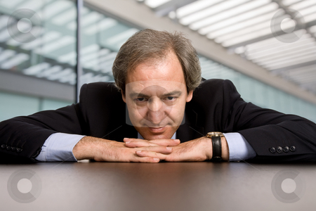 Thinking stock photo, Mature business man on a desk at the office by Rui Vale de Sousa