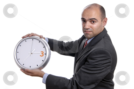 Clock stock photo, Young handsome business man holding a clock by Rui Vale de Sousa