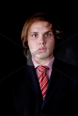 Man stock photo, Young business man portrait on black background by Rui Vale de Sousa