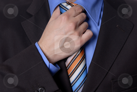 Colored tie stock photo, Detail of a Business man Suit with colored tie by Rui Vale de Sousa