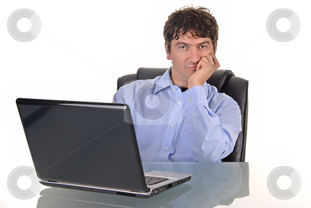 Working stock photo, Young man working with laptop. studio picture by Rui Vale de Sousa