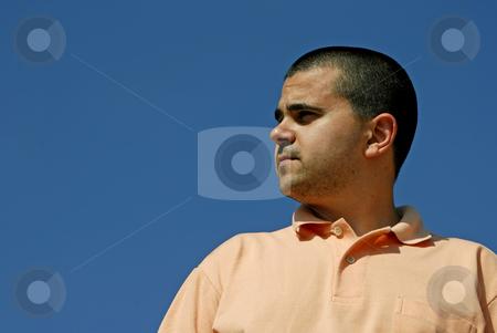 Portrait stock photo, Man portrait with the sun over a clean blue sky by Rui Vale de Sousa