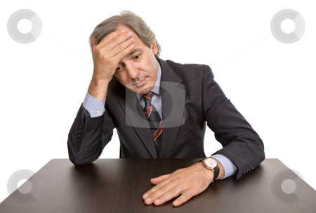 Worried stock photo, Mature business man on a desk, isolated on white by Rui Vale de Sousa