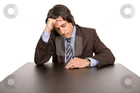 Headache stock photo, Young business man on a desk, isolated on white by Rui Vale de Sousa