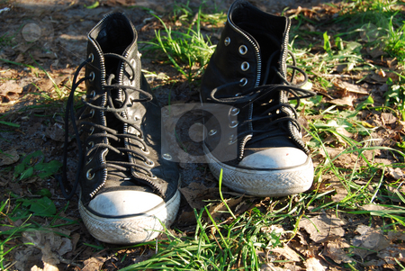 Old canvas shoes  stock photo, Old canvas shoes on the green grass by Leyla Akhundova