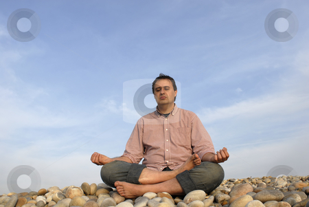 Meditation stock photo, Young man at the beach in meditation by Rui Vale de Sousa