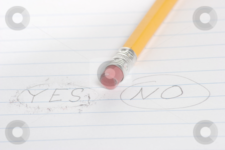 Choose yes or no stock photo, The word no is circled by a pencil with the word yes erased by Matt Baker