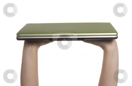 Hands holding a laptop stock photo, A womans hands are holding a laptop high overhead by Matt Baker