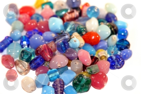 Gemstones stock photo, Colorful gemstones in a pile on white background. by Henrik Lehnerer