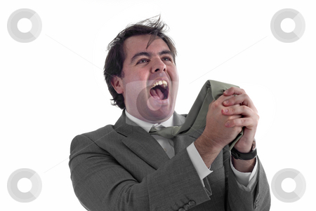 Screaming stock photo, Young business man screaming and pulling his tie by Rui Vale de Sousa