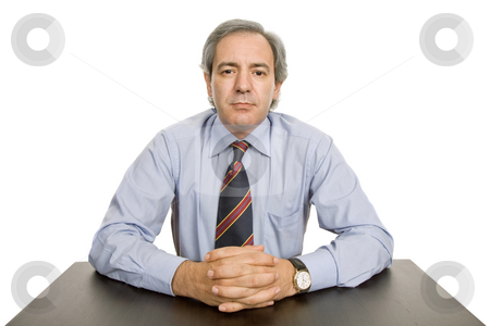 Mature stock photo, Mature business man on a desk, isolated on white by Rui Vale de Sousa