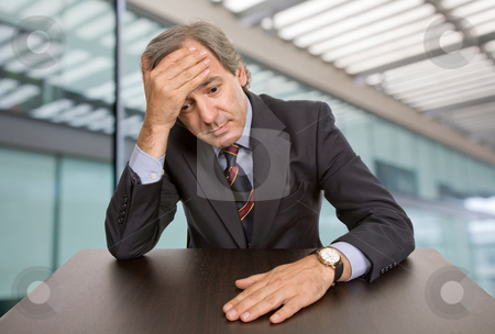 Pensive stock photo, Mature business man on a desk at the office by Rui Vale de Sousa