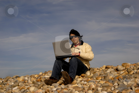 Worker stock photo, Young casual man with laptop at the beach by Rui Vale de Sousa