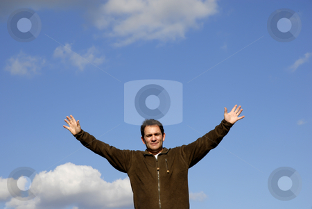 Open arms stock photo, Man with open arms and the blue sky by Rui Vale de Sousa