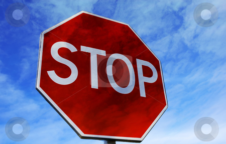 Stop stock photo, Stop street sign among clouds in the sky by Rui Vale de Sousa