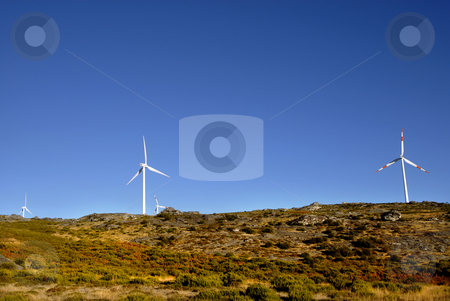 Turbine stock photo, White wind turbines in the top of the mountain by Rui Vale de Sousa