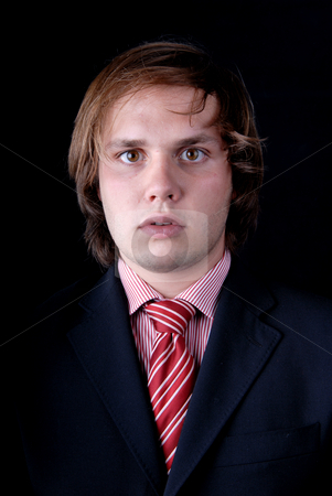 Male stock photo, Young mad man portrait on black background by Rui Vale de Sousa