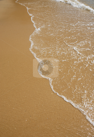 Wave stock photo, Wave at the beach detail in the sand by Rui Vale de Sousa
