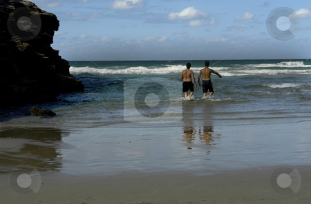 Beach stock photo, Two men having fun at the beach by Rui Vale de Sousa